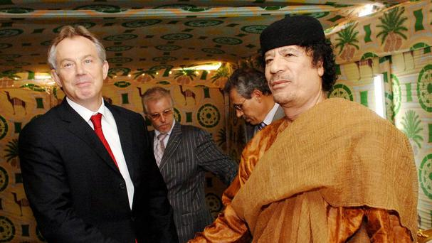 Tony Blair shakes hands with Libyan leader Colonel Muammar Gaddafi in May 2007