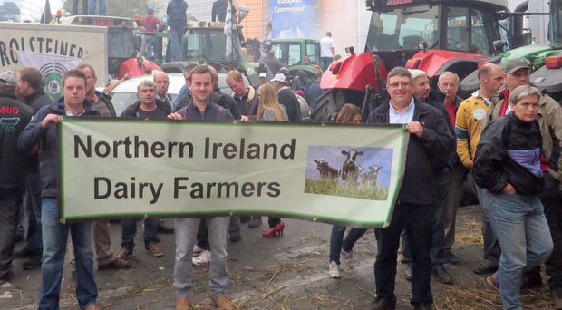 Mucking in: farmers holding a protest outside the European Commission building in Brussels last month