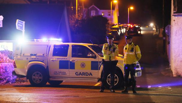 Police close off a road in Omeath, Co Louth after two men, one of whom was a garda in the Irish police force, were shot dead