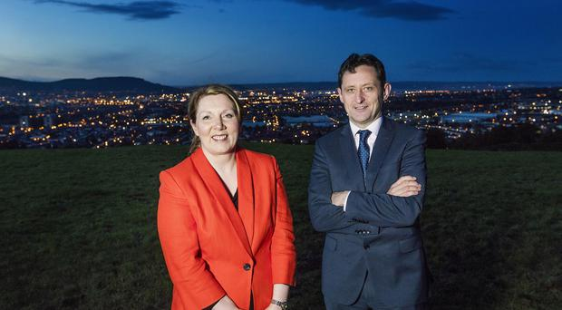 Electric Ireland sales and marketing manager Clare McAllister and executive director Jim Dollard (Electric Ireland/PA)