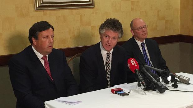 Jonathan Powell announces the loyalist initiative at Belfast's Park Avenue Hotel, with businessman David Campbell (left) and solicitor Richard Monteith (right) - both of whom worked as advisers