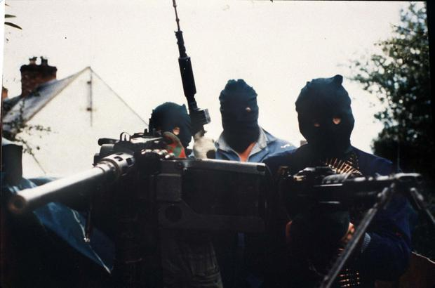 IRA gunmen with heavy machine guns mounted on the back of a lorry prepare to attack an Army helicopter in south Armagh