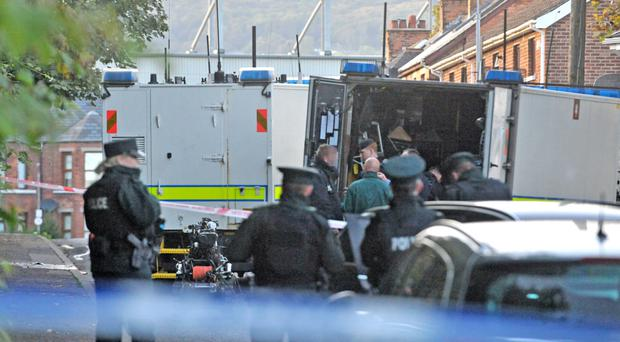 Police attend the scene of a security alert at Linden Gardens in north Belfast yesterday