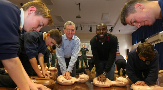 Retired footballer Fabrice Muamba, right, who suffered a cardiac arrest during a match in 2012, helps launch a previous CPR skills campaign
