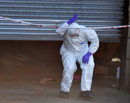 A forensic officer at the scene yesterday
