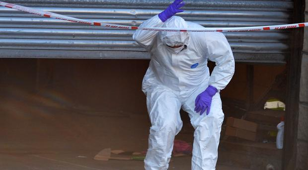 A forensic officer at the scene of the murder.