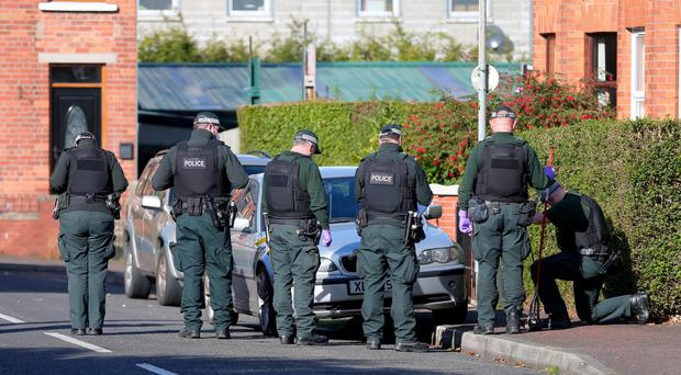 Police at Linden Gardens yesterday after a bomb was found by a young boy on Thursday afternoon