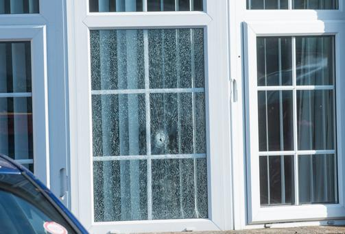 A twelve-year-old girl and her parents have fled their home in the Waterside area of Londonderry after shots were fired through a window