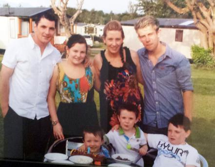 Alexis McCarron with her family, husband Martin (back row, left), daughter Alanna and son Michael (back right) and (front row) sons Ethan, Tiarnan and Ryan