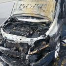 Co Down couple Laura and Ian Sharratt's car after it went on fire