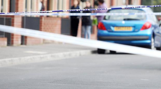 A knife lies on the ground at the scene of the stabbing on the Limestone Road in north Belfast