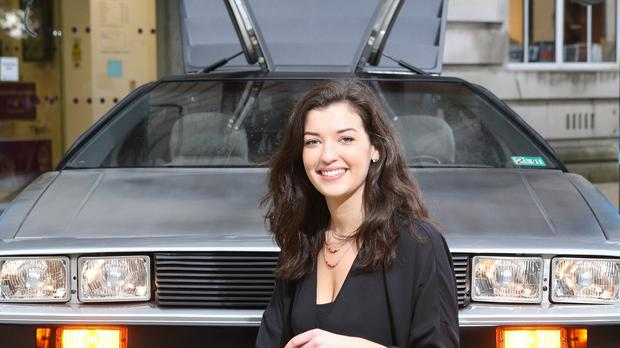 Queen's University Belfast Electrical Engineering student Niki Jackson with Queen's Electric DeLorean