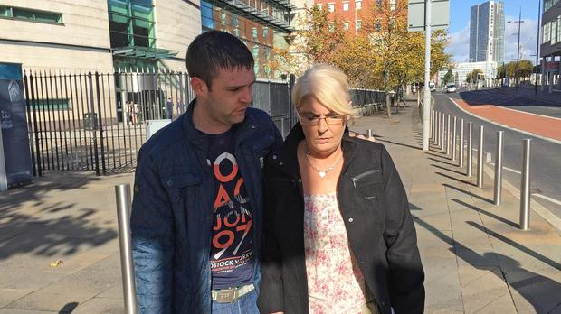 Kathleen Arkinson and her son leave Laganside court in Belfast after a preliminary inquest hearing for her sister Arlene Arkinson.