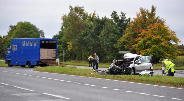 Police at the scene of the crash on the A26 Lisnevenagh Road between Ballymena and Antrim