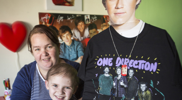 Nine-year-old Molly Taylor with mum Lisa, along with a giant cut-out of Niall Horan