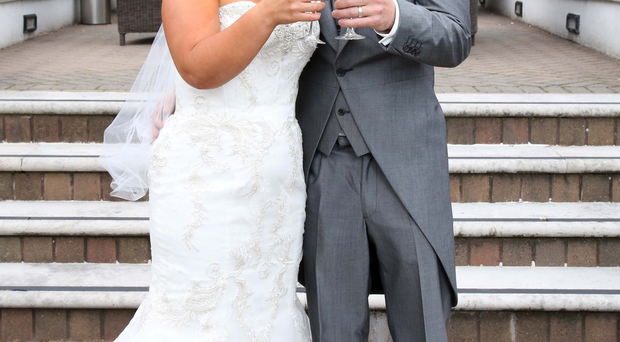 Neil and Leonie McCluskey enjoy their wedding reception