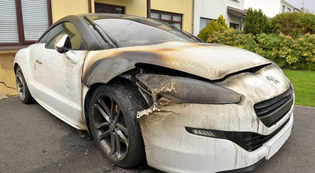 The charred remains of the car which was set alight in Banbridge yesterday