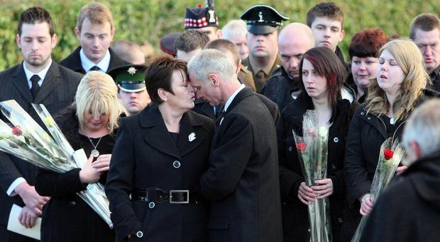 Margaret McCormick, centre, pictured at her son's Aaron's funeral