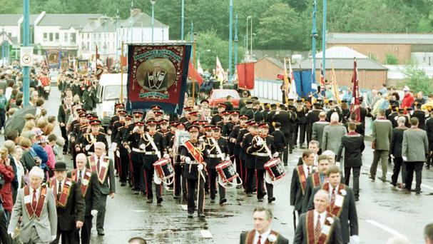 A 2001 Apprentice Boys parade marches over Craigavon Bridge in Derry, which has been given listed status