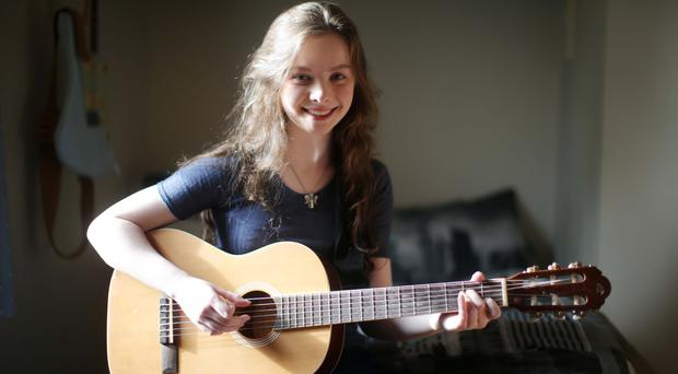 Songwriter Mollie McGinn (16) at home