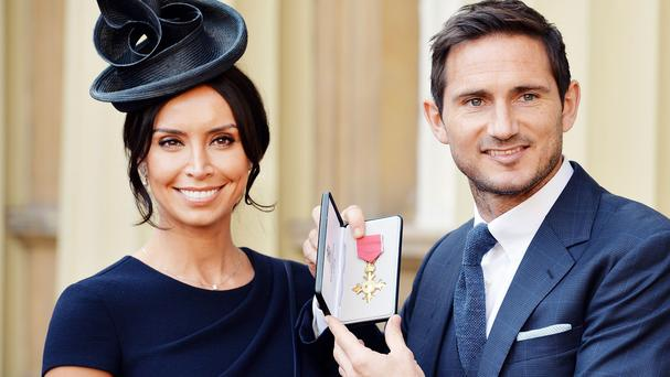 Frank Lampard with partner Christine Bleakley after he was presented with the OBE at Buckingham Palace