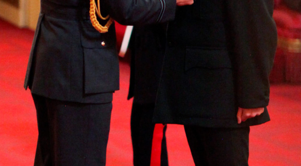 Lieutenant Colonel Kenny is presented with his OBE by the Duke of Cambridge at Buckingham Palace yesterday