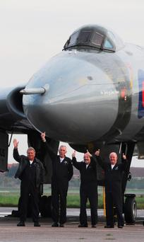 The crew (from left) Jonathan Lazzari, Bill Ramsey, Martin Withers and Phil Davies, wave in front of the aircraft