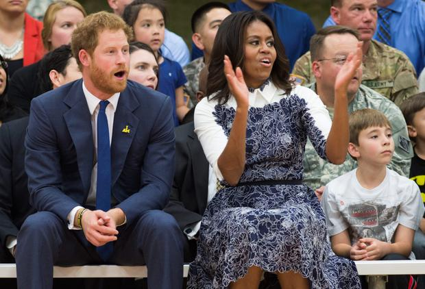 First Lady Michelle Obama and Prince Harry at a Wounded Warriors wheelchair basketball game