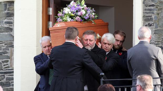 The coffin of John Rodgers, 28, who died last month after getting caught in a rip tide at Plettenberg Bay with his wife Lynette, 26, while on honeymoon in South Africa, is carried out of the First Presbyterian Church, in Hollywood, Co Down