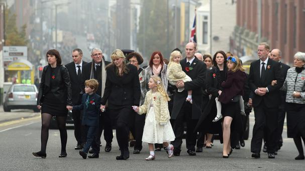 Jen Phillips arrives with daughters Sophie, three, and Abigail, seven, at Liverpool's Anglican Cathedral for the funeral of her husband Pc Dave Phillips
