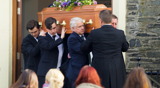 Mourners gather for the funeral of newly-weds John and Lynette Rodgers at Holywood Presbyterian Church yesterday