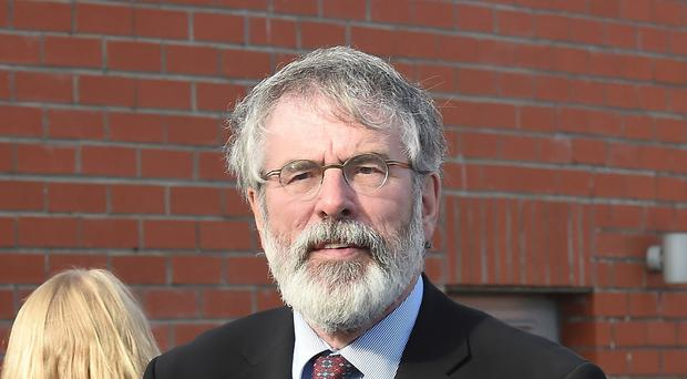 Sinn Fein president Gerry Adams has accused British intelligence chiefs of putting peace in Northern Ireland at risk in a bid to stop the growth of his party.