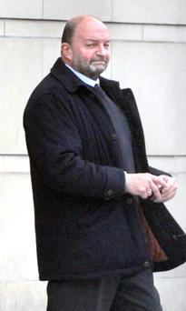 Guilty Stronge leaves Belfast Crown Court yesterday