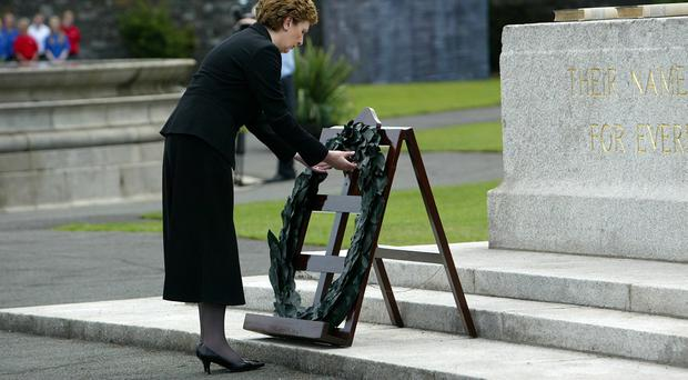Former Irish President Mary McAleese laying a wreath at the 90th anniversary commemoration of the Battle of the Somme at the Irish National War Memorial Park, Islandbridge, in 2006