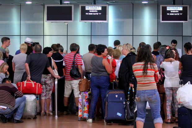 Tourists queue at Sharm el-Sheikh airport