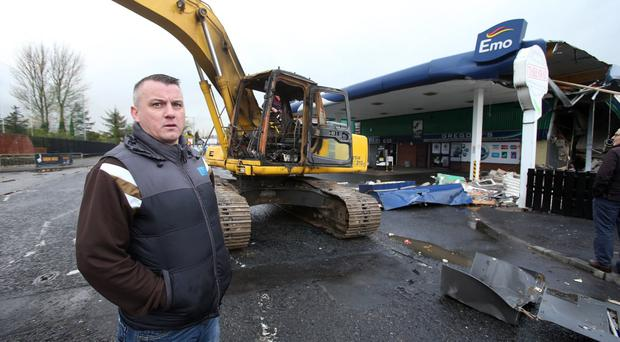 Andrew Gregory at the family petrol station in Newry yesterday after a digger was used to steal an ATM