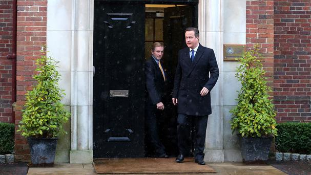Taoiseach Enda Kenny and Prime Minister David Cameron leaving Stormont House in Belfast. A UN human rights expert is to offer advice on implementing the Stormont House agreement