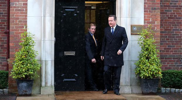 Taoiseach Enda Kenny and Prime Minister David Cameron leaving Stormont House in Belfast.