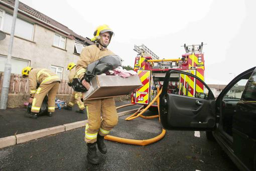 The scene in Bracken Avenue in Newcastle, Co Down, yesterday after a fire broke out overnight. Fifty firefighters were called to tackle the blaze and help residents evacuate their homes