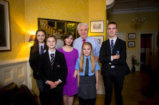 Alasdair McDonnell at his home in south Belfast yesterday with his wife Olivia and children Dearbhla (16), Ruairi (15), Oisin (12) and Aileen (10)