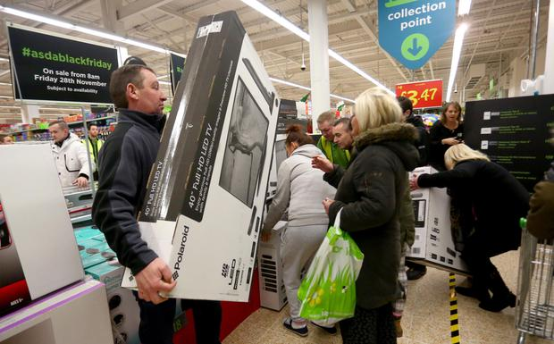 Chaotic scenes in Asda last year as crowds of frantic shoppers jostle for bargains