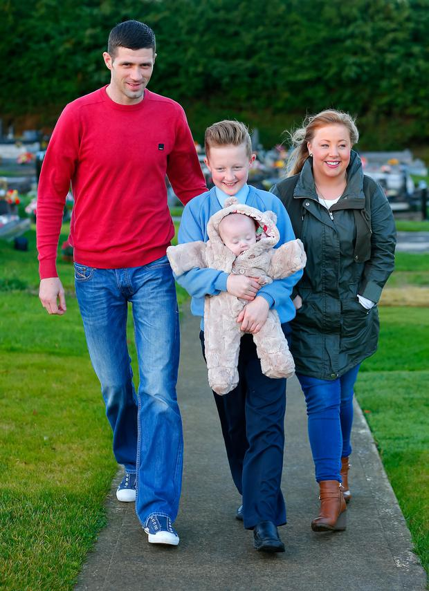 Carla Downey with her husband Lee, the couple's 11-year-old son Keelan, and five-month-old daughter Carleigh Alannah