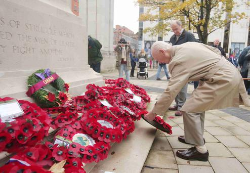 RAF veteran Bob Brooks lays a wreath in memory of his comrades at Belfast City Hall yesterday