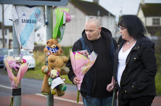 Parents Sarah Hanna and Stephen Gilmour visit the scene where Adam Gilmour died in a road accident a year ago