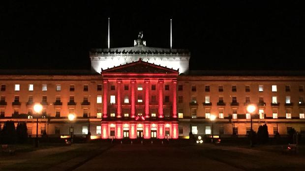 Stormont's Parliament Buildings illuminated in red for Armistice Day