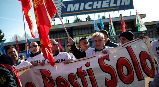 Michelin workers in Cuneo, northern Italy, protest yesterday against plans to close production sites in Fossano, Italy, Oranienburg, Germany, and Ballymena, Co Antrim