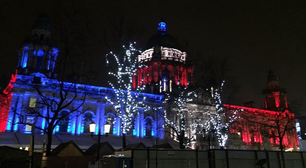 Belfast City Hall illuminated with the colours of the French tricolor