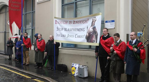 The cape-wearing protesters outside the Black Box yesterday
