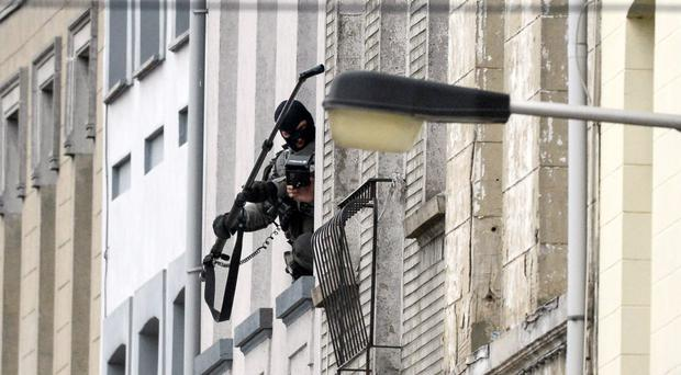 Special forces conduct a search in the Molenbeek district of Brussels