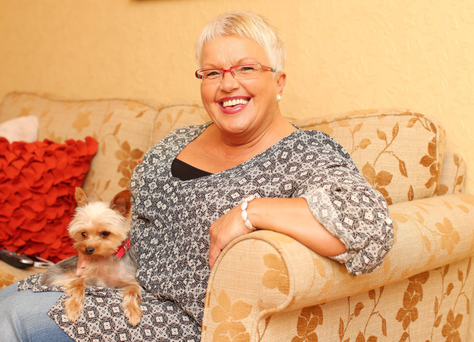 Ruth Patterson at home in east Belfast with her pet dog Paisley